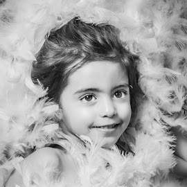 Mademoiselle plume by Nathalie Gemy - Babies & Children Child Portraits ( boa, girl, black and white, child smile, feathers, portrait, kid )