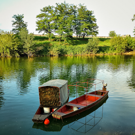 On river Kupa fishing wooden boats  by Oliver Švob - Instagram & Mobile Android ( water, reflection, instagram, europe, sojny, boats, croatia, fishing boat, sony xperia, wooden, karlovac, kupa, river, mobile,  )