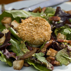 Warm Nut Encrusted Goat Cheese Salad with Bacon Lardons