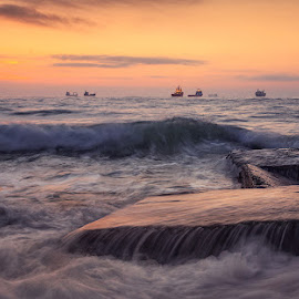 Before the sunrise by Nikolay Stoilov - Landscapes Waterscapes ( water, orange, before, wave, sea, stone, rock, sunrise, sun )