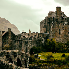 Eilean Donan Castle by Gaby Wernicke - Buildings & Architecture Public & Historical ( scotland, hill, architecture, highlands, history, historical district, nature, eilean donan, fog, castle, bridge, historical, medieval, mist )