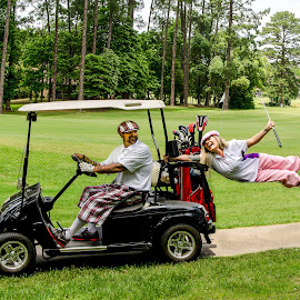Hangin' On by Michele Dan - Sports & Fitness Golf ( golf cart, golf course, levitation, golf, couples golf, golfers, knickers )