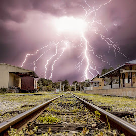 Tracks under attack by Craig Eccles - News & Events Weather & Storms ( thunder, lightning storm, news, lightning, train station, lightning bolt, event, train, cloud, thunder storm, thunder bolt, rain., storm weather )