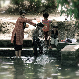 River Washing Kerala by Chris Bannocks - People Family ( backwaters, family, kerala, washing )