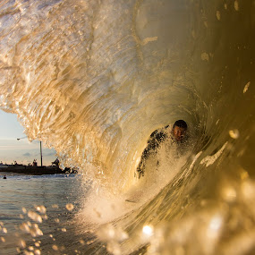 Joey tucking into a small barrel by Dave Nilsen - Sports & Fitness Surfing
