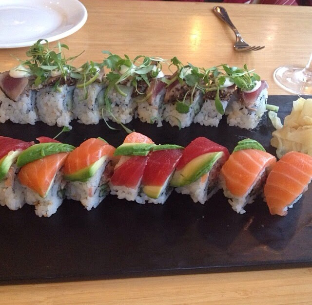 California roll with rainbow sashimi and the scallop ceviche roll topped with seared peppered tuna a