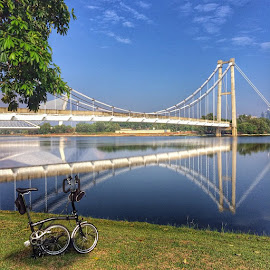 The abandoned monorail bridge by Rozi Rahman - Instagram & Mobile iPhone ( reflection, brompton, iphonegraphy, putrajaya, cycling, bromptonmalaysia, iphonewonders, bridges, amazingputrajaya )