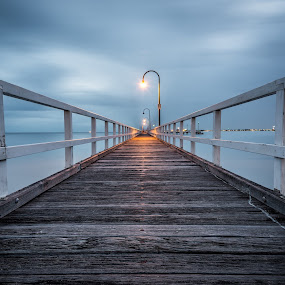 The Passage by Zubair Aslam - Landscapes Waterscapes ( cool, water, warm, melbourne, waterscape, warm and cold, still, nightscape, leading lines, port melbourne, piers, cold, blue, pier, long exposure, moving clouds, still water,  )