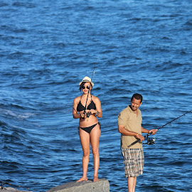 FISHING ON A ROCK by Ron Kreft - People Couples