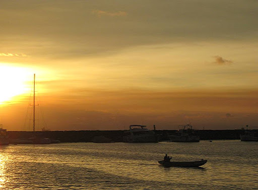 sunset across the breakwater of the Manila Yacht Club