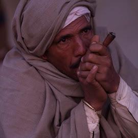 First Smoke by Janet Marsh - People Portraits of Men ( pushkar, smoking, india,  )