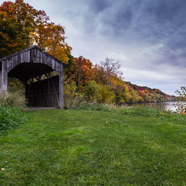 River's Edge by Laura Robles - Buildings & Architecture Bridges & Suspended Structures ( water, michigan, autumn, covered bridge, grand river, bridge, leaves, river, fall, color, colorful, nature )