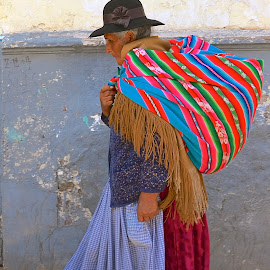 Woman walking out of the market by Tyrell Heaton - News & Events Health ( peru, markets, woman, candid, health )