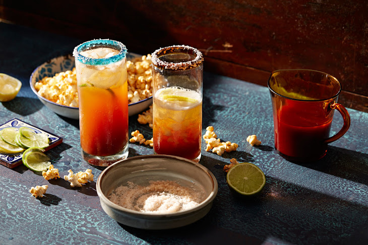 Mexican-style beer Bloody Mary with lime and chilli popcorn (michelada ...