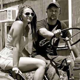 MAN & BEAUTIFUL WOMAN ON TRACTOR by Doug Hilson - People Couples