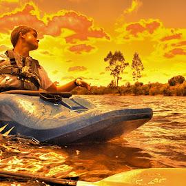 Orange Kayaker by Matt Dittsworth - Sports & Fitness Watersports ( water, orange, sky, blue, sports, lake, kayak, boy, man, fire )