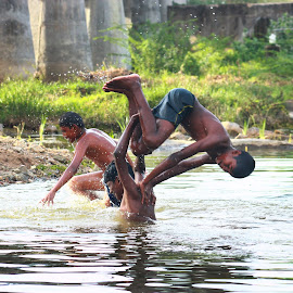 swimming by Selvakumar Kanthavel - Sports & Fitness Swimming ( water, villege, rivers, swimming )