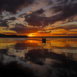 Sunset over Lake Rotorua, New Zealand by Stephen Milner - Landscapes Sunsets & Sunrises ( lake rotorua, sunset, fishing boat, new zealand, stephen milner,  )