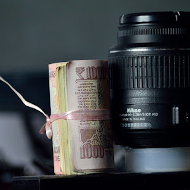 Photography is all about light and time... but the back bone is money vs lens...you pay more you get good, but the result ends up with smiles, r shrink nose. for the money wt u pay...for!........... by Murali Murliz - Digital Art Things