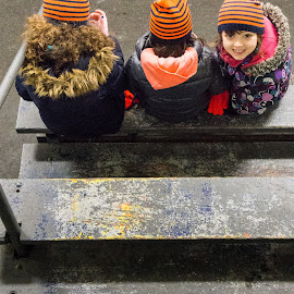 Game Time by Jennifer Bacon - Babies & Children Children Candids ( orange, girls, winter, wood, bench, arena, candid, bleacher )