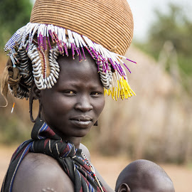 Ethiopian Woman with child by Mike O'Connor - People Street & Candids ( breast, woman, omo river valley, baby, ethiopia,  )