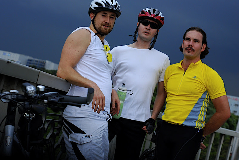 UK Mike, Canadian Mike, and Jason cycling near Haneda Airport