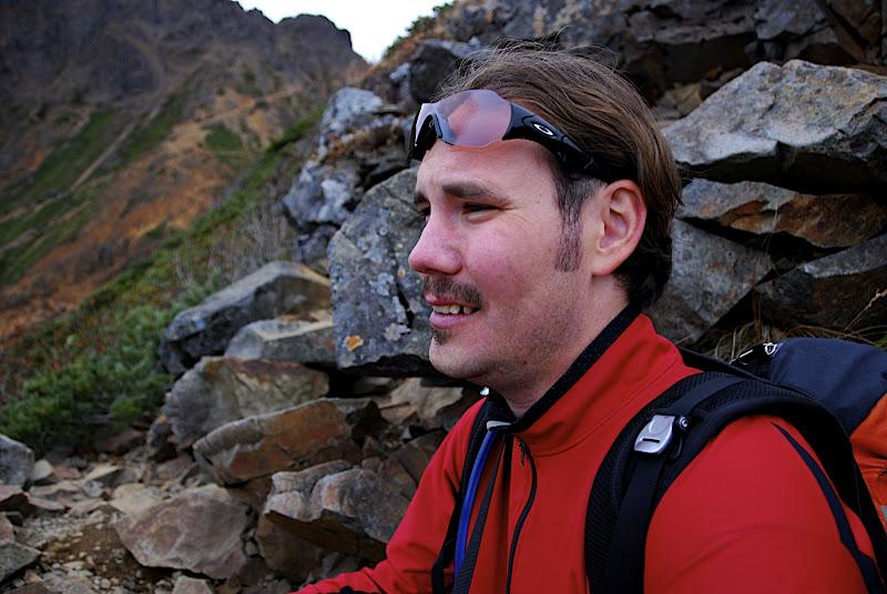 Jason takes a breather on an alpine ledge