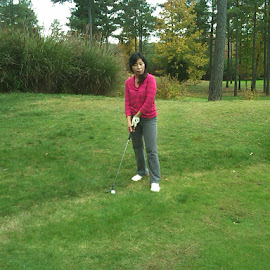 Playing golf by Laddawan Donohue - Sports & Fitness Golf ( golfing, woman, playing golf, golf, sport )