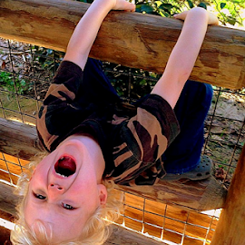 Roar by Jay Rives - Babies & Children Children Candids ( boy pretends to roar like a lion, boy roars like a lion, boy at zoo, blond haired boy. boy at a zoo )