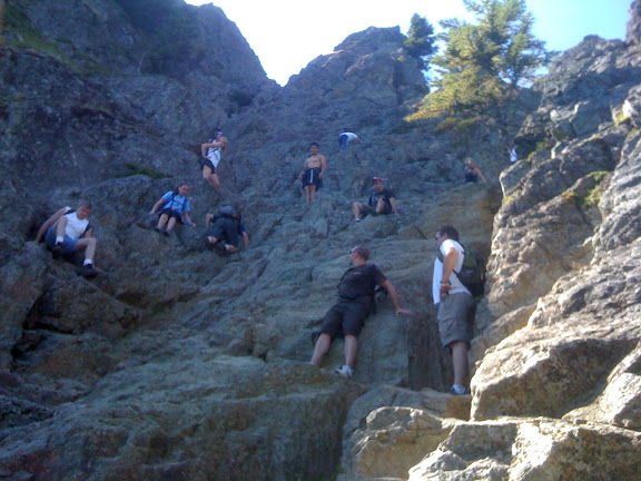 Crowded cliff on the way off the haystack