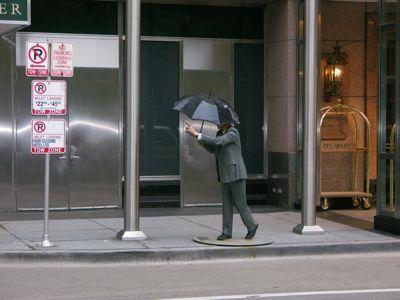 Man hailing a taxi sculpture.jpg