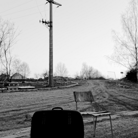 Chair with suitcase at country road by Denny Gruner - Landscapes Travel ( nobody, old, one, luggage, retro, pebbles, object, road, landscape, gravel, furniture, worn out, sky, nature, seat, shingle, decayed, black, electricity pylon, suitcase, vintage, white, rural, country, field, sign, dilapidated, chair, outdoor, trees )