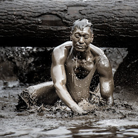 Is He A Statue? by Shane McKenzie - Sports & Fitness Other Sports ( water, mud, splash, race, man )