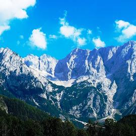 View from Zgornje Jezersko by Petra Cvetko - Landscapes Mountains & Hills ( hills, mountains, mountain, sunny, view, rocks, woods )