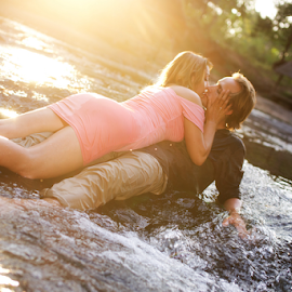 by Joe Bowers - People Couples ( water, kiss, kissing, couple, wet, river )