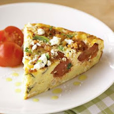Cherry Tomato Frittata with Corn, Basil and Goat Cheese