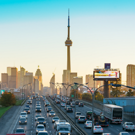 CN Tower in Rush Hour by Robert Machado - Landscapes Travel ( highway, symbol, toronto, national, driving, stress, image, photo, city, tower, expressway, iconic, lifestyle, canadian, cn tower, commuting, gardiner )