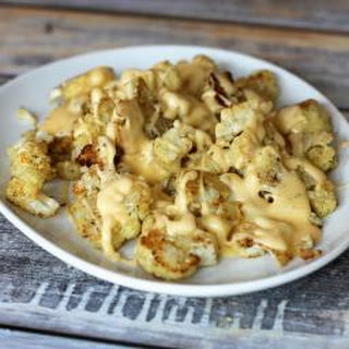 Roasted Cauliflower with Cheddar Sauce