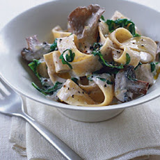 Pasta With Mushroom Sauce And Wilted Leaves