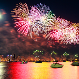 Red firework by Krissanapong Wongsawarng - Public Holidays New Year's Eve ( perth, australia )