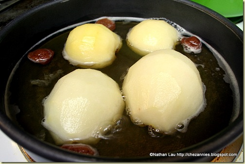 Asian pears boiling in sake
