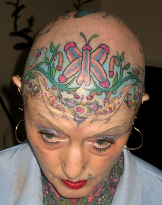 Head and Face tattoos. Are they knobs on her head?