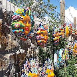 Suns on a Fence by Anne Johnson - City,  Street & Park  Markets & Shops ( sun decoration, market, decoration, yard art, pottery, sun )