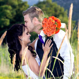 the kiss by Aretha De Jager Botha - People Couples ( orange, kiss, couple, maried, flower,  )
