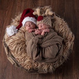 Newborn Christmas Twins by George Holt - Babies & Children Child Portraits ( reindeer, babies, boys, christmas, sleeping, santa hat, infants, twins, newborn, brothers )