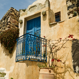 Blue Door by Patricia Kousaleos - Buildings & Architecture Homes ( urn, greece, door, architecture, santorini, blue, orange. color )