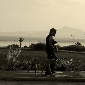 Strangers by Camelia Cami - People Street & Candids ( strangers, sunset, street, photographer, lady, dog, man, city )