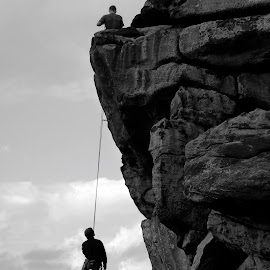 Hanging Around 2 by Darrell Evans - Sports & Fitness Climbing ( face, climb, black and white, rock, hang, landscape, people, almscliff, hanging, teamwork, england, sky, nature, rope, yorkshire, activity, man, clouds, moorland, uk, greyscale, gritstone, grass, cliff, hoist, hobby, leisure, crag, rural, rock face, field, r almscliff crag, climbing, moors, high, climber )