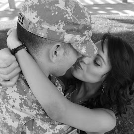 Soldier's wife by Nadine Lopez - People Couples ( love, army, kiss, hug, uniform )