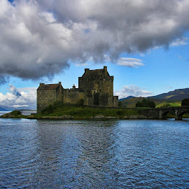 Eilean Donan Castle , Scotland by Gianluca Presto - Landscapes Travel ( water, clouds, scotland, eilean donan, tourism, castle, lake, travel, landscape, landscapes, historic )